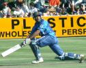 Lloyd Ferreira paddles a ball to the boundary