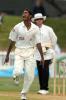 Bangladesh bowler Manjural Islam celebrates the dismissal of New Zealand batsman Stephen Fleming, caught behind by wicket-keeper Khaled Mashud for 61. Umpire Brent Bowden looks on. 2nd Test: New Zealand v Bangladesh at Basin Reserve, Wellington, 26-30 Dec 2001 (29 December 2001).