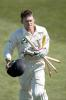 New Zealand batsman Lou Vincent runs from the field with a clutch of stumps after New Zealand won the match, beating India by 10 wickets. Vincent ended his second innings on 21 not out. 1st Test: New Zealand v India at Basin Reserve, Wellington, 12-16 December 2002 (14 December 2002).