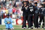 Indian batsman Virender Sehwag awaits his fate from the third umpire as members of the New Zealand team celebrate his run out for 108. From left: Sehwag, Stephen Fleming, Craig McMillan, Daryl Tuffey (obscured), Paul Hitchcock, Mathew Sinclair, Brendon McCullum and Jacob Oram. 2nd ODI: New Zealand v India at McLean Park, Napier, 29 December 2002.